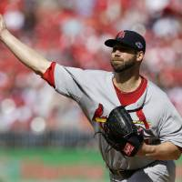 Photo -   St. Louis Cardinals starting pitcher Chris Carpenter throws against the Washington Nationals in the first inning of Game 3 of the National League division baseball series on Wednesday, Oct. 10, 2012, in Washington. (AP Photo/Alex Brandon)
