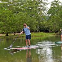 Photo -  Lovers of the outdoors in Isabela, Puerto Rico, try their hand at river paddle-boarding. Photo courtesy of Ellen Clark.