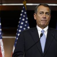 Photo - House Speaker Rep. John Boehner of Ohio, pauses while speaking to the media about the fiscal cliff on Capitol Hill in Washington, on Thursday, Dec. 20, 2012. (AP Photo/Jacquelyn Martin)