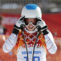 Photo - United States' Julia Mancuso takes off her goggles after a women's downhill training run for the Sochi 2014 Winter Olympics, Friday, Feb. 7, 2014, in Krasnaya Polyana, Russia. (AP Photo/Christophe Ena)