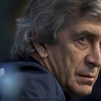 Photo - Manchester City manager Manuel Pellegrini waits to answer questions during a press conference at the Etihad Stadium, Manchester, England, Monday Feb. 17, 2014. Manchester City will play Barcelona on Tuesday in a Champions League first knock out round soccer match. (AP Photo/Jon Super)