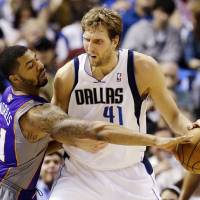 Photo - Dallas Mavericks' Dirk Nowitzki (41), of Germany, fights Phoenix Suns' Markieff Morris (11) for an opening to the basket in the first half of an NBA basketball game, Sunday, Jan. 27, 2013, in Dallas. (AP Photo/Tony Gutierrez)