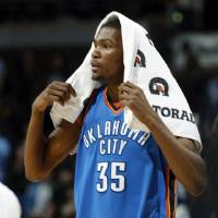 Photo - Oklahoma City Thunder forward Kevin Durant covers his head with a towel as he leaves the court after the Denver Nuggets' 119-90 victory over the Thunder in an NBA basketball game in Denver on Wednesday, March 3, 2010. (AP Photo/David Zalubowski) ORG XMIT: CODZ112