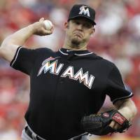 Photo - Miami Marlins starting pitcher Brad Penny throws against the Cincinnati Reds in the first inning of a baseball game, Saturday, Aug. 9, 2014, in Cincinnati. (AP Photo/Al Behrman)