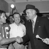 Photo - FILE - This Jan. 1, 1970 file photo shows former President Lyndon B. Johnson congratulating University of Texas quarterback James Street and coach Darrell Royal, center, in the dressing room after the Longhorns defeated Notre Dame in the Cotton Bowl in Dallas.  Street, who took over the Longhorns' wishbone offense and led them to the 1969 national championship, has died. He was 65. Serena Fitchard of the James Street Group said Street died early Monday, Sept. 30, 2013. (AP Photo/File)