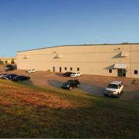 Photo - Gardner Tanenbaum developed this warehouse, which is fully leased, on Partnership Drive east of Interstate 35 and north of Hefner Road.  PHOTO PROVIDED BY PRICE EDWARDS & CO.