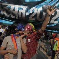 Photo -   Participants gather for the 5th Delhi Queer Pride parade in New Delhi, India, Sunday, Nov. 25, 2012. Hundreds of gay rights activists marched through New Delhi on Sunday to demand that they be allowed to lead lives of dignity in India's deeply conservative society.(AP Photo/ Mustafa Quraishi)