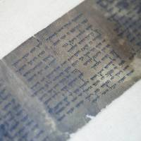 Photo - This Friday, May 10, 2013 photo shows the ten commandments written on one of the Dead Sea Scrolls in Jerusalem. Nearly 70 years after the discovery of the world's oldest biblical manuscripts, the Palestinian family who originally sold them to scholars and institutions is now quietly marketing the leftovers - fragments the family says it has kept in a Swiss safe deposit box all these years. (AP Photo/Dan Balilty)