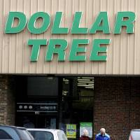 Photo - FILE - In this Monday, Feb. 8, 2010, file photo, shoppers walk out of a Dollar Tree store in Barre, Vt. Dollar Tree is buying rival discount store Family Dollar in a cash-and-stock deal valued at about $8.5 billion, the companies announced Monday, July 28, 2014. (AP Photo/Toby Talbot, File)