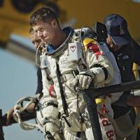 Photo -   This photo provided by Red Bull Stratos shows pilot Felix Baumgartner of Austria reacting after his mission was aborted in Roswell, N.M., Tuesday, Oct. 9, 2012. For the second straight day, extreme athlete Felix Baumgartner aborted his planned death-defying 23-mile free fall because of the weather, postponing his quest to become the world's first supersonic skydiver until at least Thursday. (AP Photo/Red Bull Stratos, Joerg Mitter)