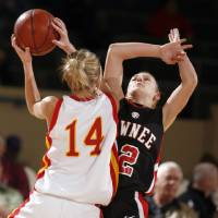 Photo - Pawnee's Shelbi Bear (12) and Dale's Emilee Lawson (14) collide during the girls 2A semifinal between Dale and Pawnee at the State Fair Arena, Friday, March 13, 2009, in Oklahoma City. PHOTO BY SARAH PHIPPS, THE OKLAHOMAN