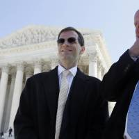 Photo - Mike Carvin, counsel for the National Federation of Independent Businesses, right, speaks with plaintiff David Klemencic who runs a flooring business in Ellenboro, W.Va., outside the Supreme Court in Washington, Tuesday, March 27, 2012, after the court heard arguments on the health care reform law signed by President Barack Obama in Washington. (AP Photo/Charles Dharapak) ORG XMIT: DCCD118