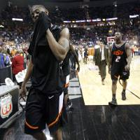 Photo - COLLEGE BASKETBALL, BIG 12 TOURNAMENT: OSU's James Anderson walks off the court after OSU's loss in the second round game of the Men's Big 12 Basketball Championship between Oklahoma State University and Texas at The Sprint Center on Friday, March 14, 2008, in Kansas City, Mo.    BY BRYAN TERRY, THE OKLAHOMAN ORG XMIT: KOD