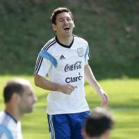 Photo - Argentina's Lionel Messi laughs during a training session in Vespasiano, near Belo Horizonte, Brazil, Friday, June 20, 2014.  Argentina plays in group F of the 2014 soccer World Cup. (AP Photo/Victor R. Caivano)