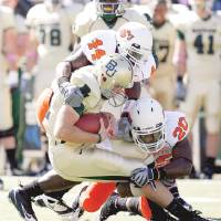 Photo - OSU's Donald Booker, top, and Andre Sexton bring down Baylor quarterback Nick Florence during Saturday's game in Waco, Texas. Photo by Sarah Phipps, The Oklahoman