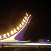 Photo - The Olympic Cauldron is lit during the opening ceremony of the 2014 Winter Olympics in Sochi, Russia, Friday, Feb. 7, 2014. (AP Photo/Darron Cummings)