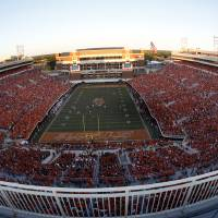 Photo - OVERVIEW / CROWD: Boone Pickens Stadium is pictured during a college football game between the Oklahoma State University Cowboys (OSU) and the University of Arizona Wildcats at Boone Pickens Stadium in Stillwater, Okla., Thursday, Sept. 8, 2011. Photo by Sarah Phipps, The Oklahoman  ORG XMIT: KOD