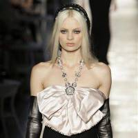 Photo - A model wears a creation of Chanel by fashion designer Karl Lagerfeld during his Women's Fall Winter 2013 haute couture fashion collection in Paris, France, Tuesday, July 3, 2012. (AP Photo/Francois Mori)