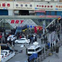 Photo - Security personnel gather near the scene of an explosion outside the Urumqi South Railway Station in Urumqi in northwest China's Xinjiang Uygur Autonomous Region on Wednesday April 30, 2014.  An explosion shook the railway station in China's restive far-western region of Xinjiang, injuring many people as President Xi Jinping wrapped up a four-day visit to the area, state media said Wednesday. (AP Photo) CHINA OUT ONLINE OUT