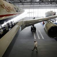 Photo - A Boeing 767 airplane sits on display at the grand opening of the new Delta Flight Museum, Tuesday, June 17, 2014, in Atlanta. Delta Air Lines is re-opening a museum at its Atlanta headquarters after extensive renovations in hopes of luring tourists to the company's original aircraft maintenance hangars on the north edge of the world's busiest airport. The 68,000-square-foot museum, housed in hangers that date to the 1940s, traces Delta's history from crop-dusting and air mail service to its first passenger flight from Dallas to Jackson, Mississippi, on June 17, 1929. (AP Photo/David Goldman)
