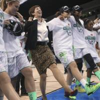 Photo - Notre Dame coach Muffet McGraw, center, dances with her players as they celebrate an 87-76 win over Duke in the regional final of the NCAA women's college basketball tournament Tuesday, April 2, 2013, in Norfolk, Va. (AP Photo/Jason Hirschfeld)