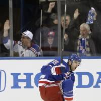 Photo - New York Rangers left wing Rick Nash (61) reacts after scoring a goal in the first period of an NHL hockey game against the Washington Capitals at Madison Square Garden in New York, Sunday, Jan. 19, 2014. Nash scored two goals in the period. (AP Photo/Kathy Willens)
