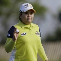 Photo - Inbee Park, of South Korea, reacts to applause after putting on the 12th hole during the first round of the U.S. Women's Open golf tournament at the Sebonack Golf Club Thursday, June 27, 2013, in Southampton, N.Y.  (AP Photo/Frank Franklin II)