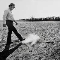 Photo - Arthur Rickets is shown kicking up dirt as he walks through a field in southern Oklahoma after the 1980 drought. This photo was taken March 1981.    JIM BECKEL - THE OKLAHOMAN, ARCHIVE PHOTO