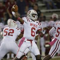 Photo -   Western Kentucky quarterback Kawaun Jakes (6) throws a pass in the first half of an NCAA college football game against Troy in Troy, Ala., Thursday, Oct. 11, 2012. (AP Photo/Dave Martin)