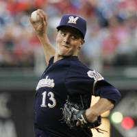 Photo -   Milwaukee Brewers' Zack Greinke throws in the first inning of a baseball game with the Philadelphia Phillies, Tuesday, July 24, 2012, in Philadelphia. (AP Photo/Tom Mihalek)