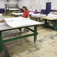 Photo - Workers at NewView Oklahoma City manufacture shower curtains.  PAUL B. SOUTHERLAND - PAUL B. SOUTHERLAND