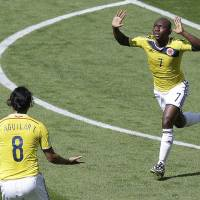 Photo - Colombia's Pablo Armero celebrates after scoring during the group C World Cup soccer match between Colombia and Greece at the Mineirao Stadium in Belo Horizonte, Brazil, Saturday, June 14, 2014.  (AP Photo/Andrew Medichini)