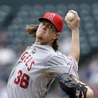 Photo - Los Angeles Angels starting pitcher Jered Weaver throws against the Seattle Mariners in the second inning of a baseball game on Sunday, Aug. 25, 2013, in Seattle. (AP Photo/Elaine Thompson)
