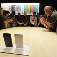 Photo - The new Apple iPhone 5 is displayed  Sept. 12 following the introduction of new products in San Francisco.  The iPhone 5 is a blend of beauty, utility and versatility. AP Photo  Eric Risberg