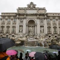 Photo - Tourists gather at Trevi's fountain, in Rome, Monday, Jan. 28, 2013. The Fendi fashion house is financing an euro 2.12 million ($2.8 million) restoration of Trevi Fountain in Rome, famed as a setting for the film
