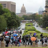 Photo -   University of Texas students evacuate campus after the university received a bomb threat Friday morning, Sept. 14, 2012 in Austin, Texas. The university received a call about 8:35 a.m. local time from a man claiming to be with al-Qaida who said he had placed bombs all over the 50,000-student Austin campus, according to University of Texas spokeswoman Rhonda Weldon. (AP Photo/Statesman.com, Ricardo B. Brazziell)