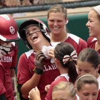 Photo - Sooner catcher Jessica Shults celebrates her home run in the fifth inning as the University of Oklahoma Sooner Softball team plays Arizona in game two of the NCAA Softball Norman Super Regional at Marita Hines field on Saturday, May 26, 2012, in Norman, Okla.  Photo by Steve Sisney, The Oklahoman
