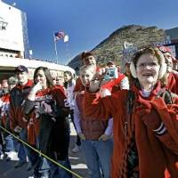 Photo - Sooner fans line up outside the stadium to welcome the team as they arrive to the Brut  Sun  Bowl college football game between the University of Oklahoma Sooners (OU) and the Stanford University Cardinals on Thursday, Dec. 31, 2009, in El Paso, Tex. Photo by Chris Landsberger, The Oklahoman