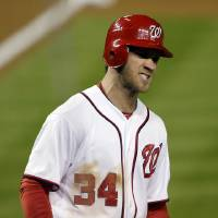 Photo -   Washington Nationals' Bryce Harper reacts after scoring on a home run by Ryan Zimmerman in the first inning of Game 5 of the National League division baseball series against the St. Louis Cardinals on Friday, Oct. 12, 2012, in Washington. (AP Photo/Pablo Martinez Monsivais)
