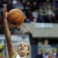 Photo - Connecticut's Bria Hartley scores in the second half of her team's 94-37 victory over Marquette in an NCAA college basketball game in Storrs, Conn., Tuesday, Feb. 5, 2013. Hartley scored 20 points in the victory. (AP Photo/Fred Beckham)