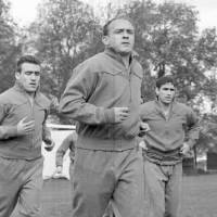 Photo - FILE - In this Oct. 25, 1960 file photo, Real Madrid's veteran player Alfredo Di Stefano, center, jogs around the Bank of England training ground, in  Roehampton, London,  England. Di Stefano, whose goals placed him alongside the all-time great players and propelled Real Madrid to five straight European Champions Cups, has died on Monday, July 7, 2014. He was 88. (AP Photo/Laurence Harris, File)