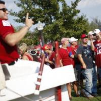 Photo - Fans take photos of the Sooner Schooner before the college football game between the University of Oklahoma Sooners and the University of Tulsa Hurricanes at the Gaylord Family - Oklahoma Memorial Stadium on Saturday in Norman.  BRYAN TERRY - BRYAN TERRY