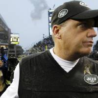 Photo -   New York Jets head coach Rex Ryan walks off the field after his team lost to the Seattle Seahawks in an NFL football game, Sunday, Nov. 11, 2012, in Seattle. The Seahawks won 28-7. (AP Photo/Elaine Thompson)