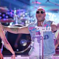 Photo -   Flo Rida performs onstage at the Teen Choice Awards on Sunday, July 22, 2012, in Universal City, Calif. (Photo by John Shearer/Invision/AP)