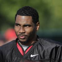 Photo - FILE - In this Aug. 9, 2014, file photo, Ohio State quarterback Braxton Miller watches teammates warm up during an NCAA college football practice in Columbus, Ohio. Miller, among the top contenders for the Heisman Trophy, reportedly reinjured his throwing shoulder during practice. The report about the two-time Big Ten offensive player of the year comes with just more than two weeks before the No. 5 Buckeyes open the season. (AP Photo/Jay LaPrete, File)