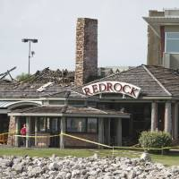 Photo - Redrock Canyon Grill, 9221 Lake Hefner Parkway, was possibly hit by lightning early Wednesday morning in Oklahoma City, May  30, 2012. Firefighters arrived and found a small fire that quickly spread into the roof and a third alarm was sounded, Photo By Steve Gooch, The Oklahoman