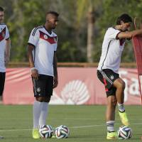 Photo - Germany's national soccer players Per Mertesacker, from left, Jerome Boateng and Sami Khedira attend a training session in Santo Andre near Porto Seguro, Brazil, Wednesday, June 18, 2014. Germany play in group G of the 2014 soccer World Cup. (AP Photo/Matthias Schrader)