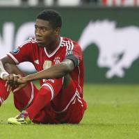 Photo - Bayern's David Alaba sits on the pitch after losing the Champions League semifinal second leg soccer match between Bayern Munich and Real Madrid at the Allianz Arena in Munich, southern Germany, Tuesday, April 29, 2014. (AP Photo/Matthias Schrader)