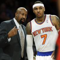 Photo - New York Knicks head coach Mike Woodson talks to Carmelo Anthony, right, during the first half of an NBA basketball game against the Toronto Raptors, Wednesday, Feb. 13, 2013, in New York. (AP Photo/Frank Franklin II)