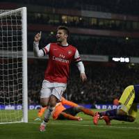 Photo - Arsenal's Olivier Giroud celebrates scoring his side's second goal during the English Premier League soccer match between Arsenal and Swansea City at the Emirates Stadium in London, Tuesday, March 25, 2014. (AP Photo/Matt Dunham)